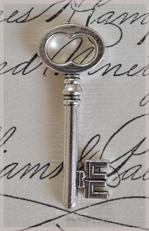Zilverkleurige sleutels. Per 3