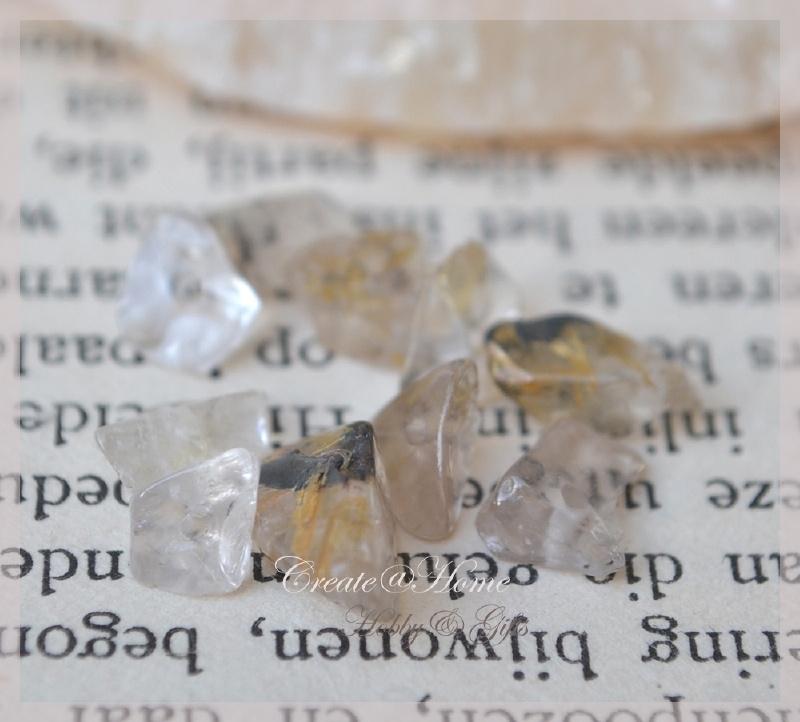Gold rutilated quartz chips in 2 afm. Per 10