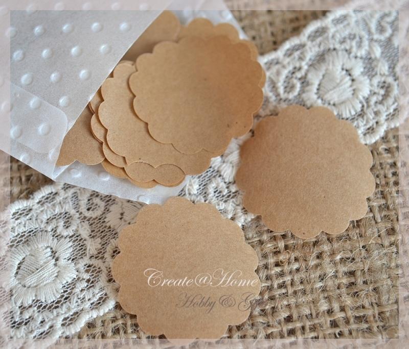 Gegomde kraftpapier sculp rondjes in het bruin.wit in een pergamijn/kraft zakje