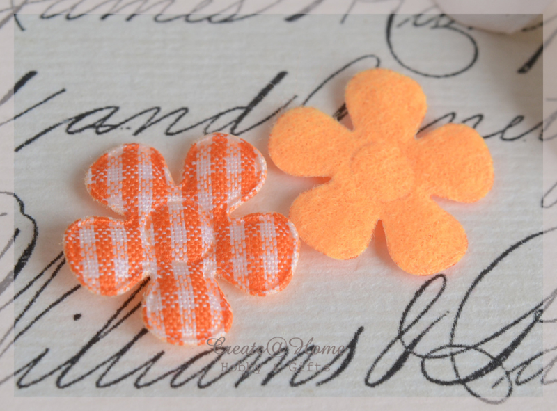 Vilt bloemetjes oranje. Per 10
