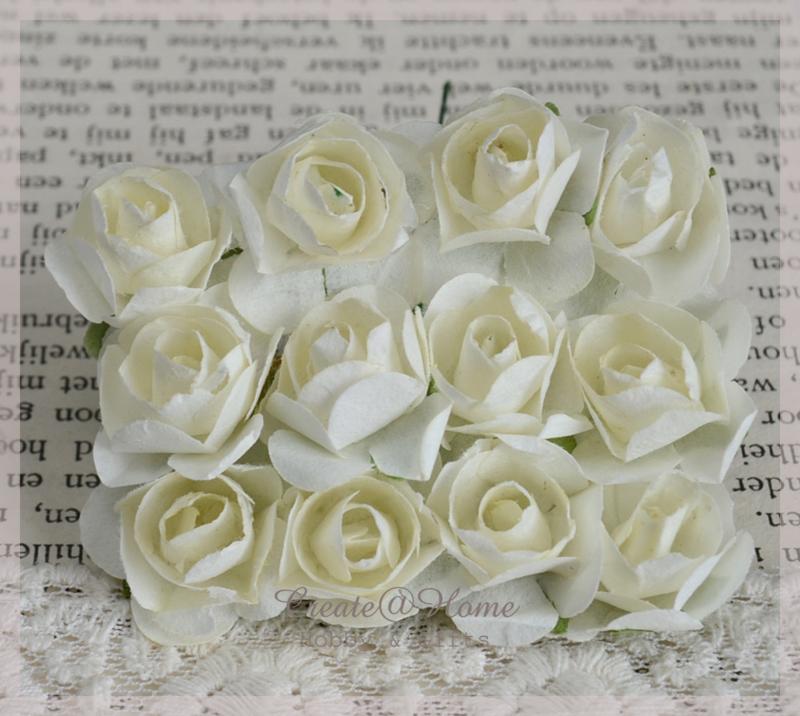 Papieren roosjes ivoor. Per 10