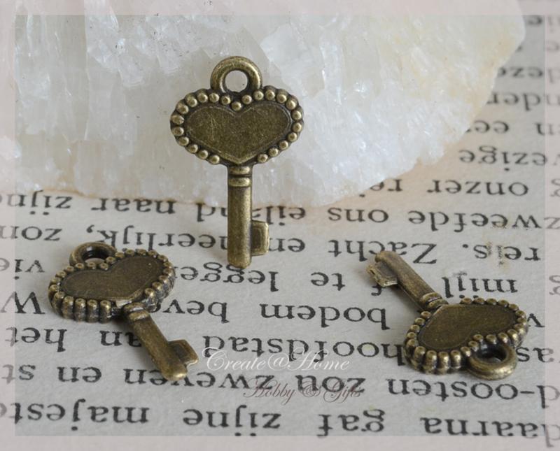 Bedel sleuteltjes brons. Per 10