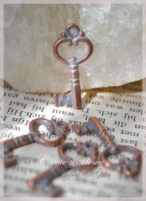 Bedel sleuteltjes metal look koper/zilver. Per 10
