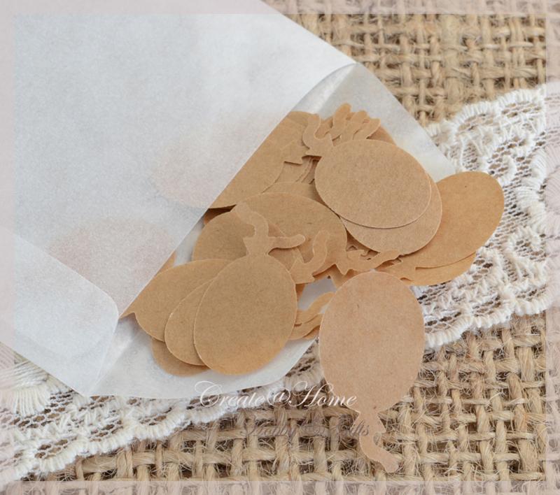 Gegomde kraftpapier ballonnetjes in het bruin/wit in een pergamijn/kraft zakje