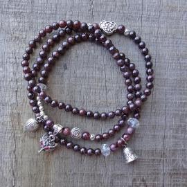 Armband met aubergine stenen kraaltjes