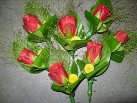 "Corsage ""Rode roos"" € 2,00"