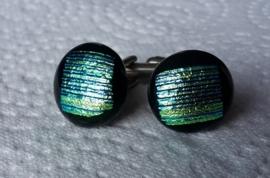 zwart met groen dichroide streepjes