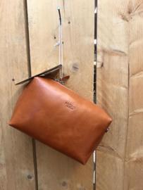 Lange schouderband met rits van boven hunter waxy ginger (oranje)