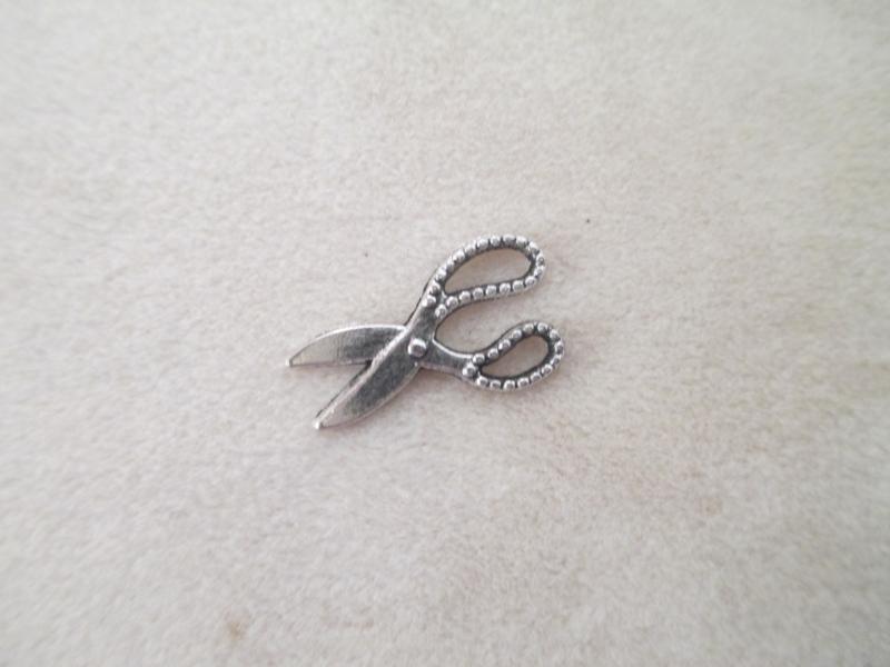 Antiek zilveren schaartjes 19 x 11 mm.