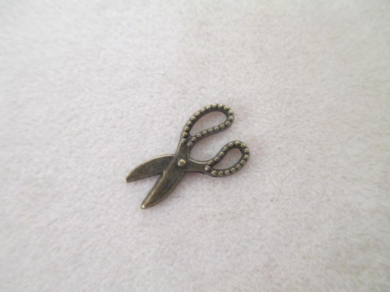 Schaartjes brons 19 x 11 mm.