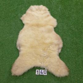 Bruin/wit gevlekte schapenvacht (110 x 70)