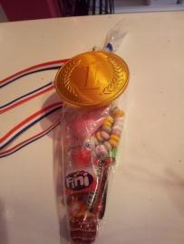 Medaille van chocolade + snoepzakje