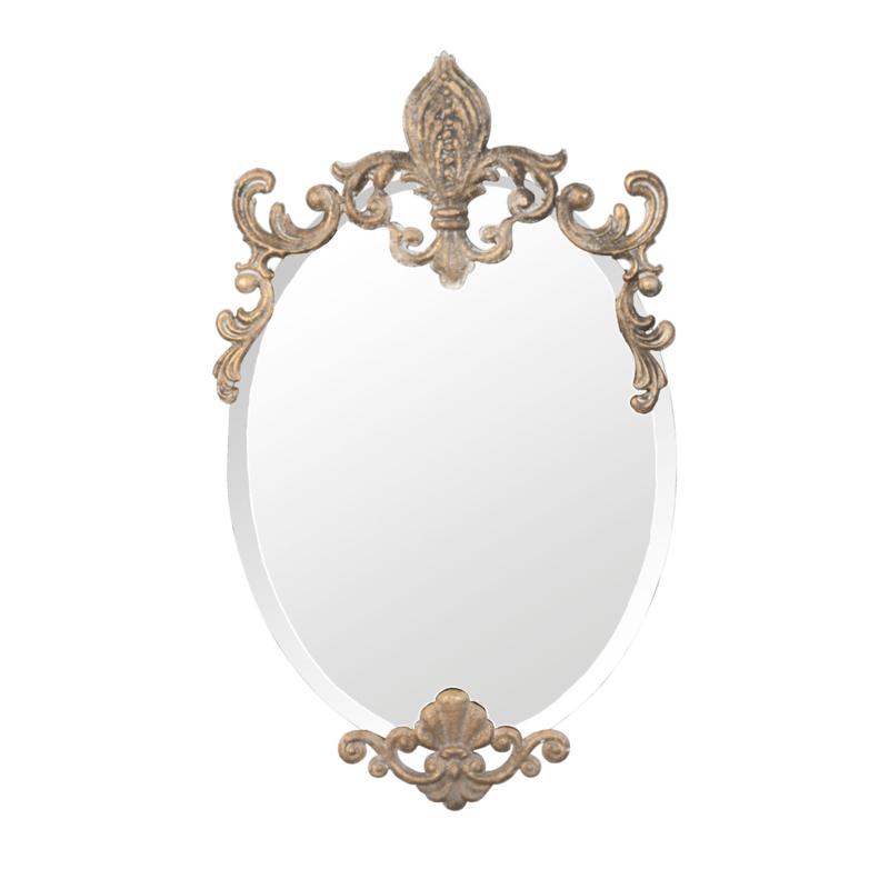 Goudkleurige sierlijke spiegel