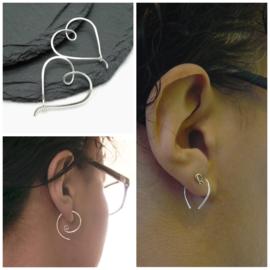 3 paar oorbellen gereserveerd
