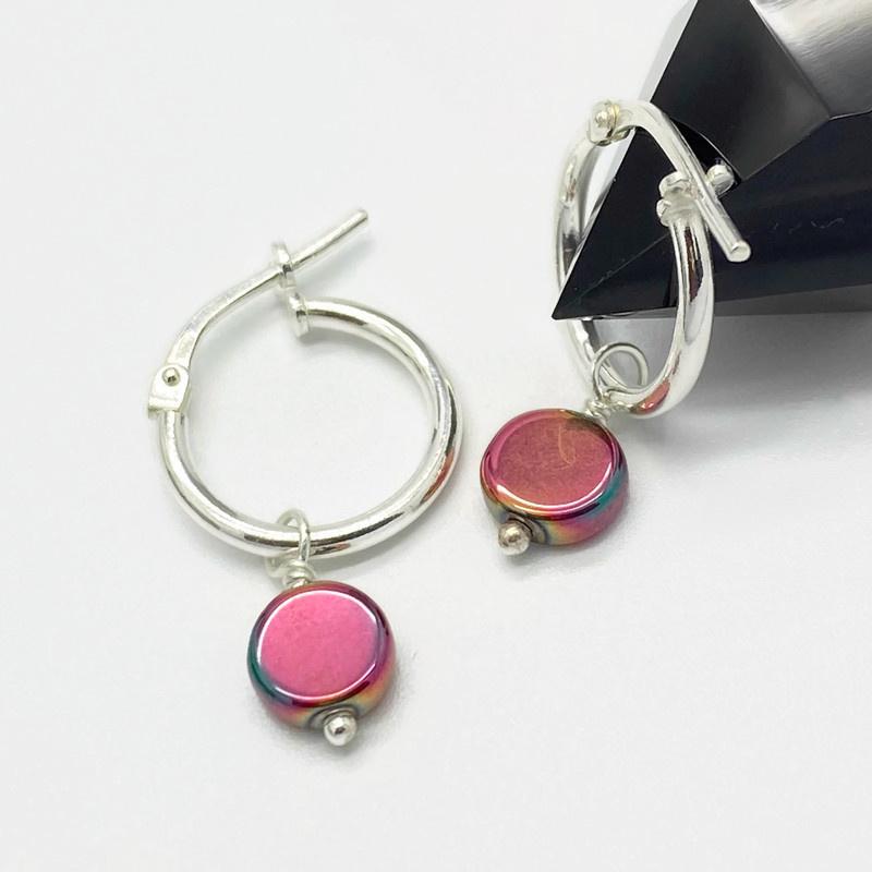 Zilveren creooltjes met hematiet oranje/roze