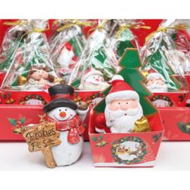 Kerstfiguur in geschenkverpakking in folie