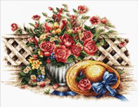 Zonnehoed met rozen
