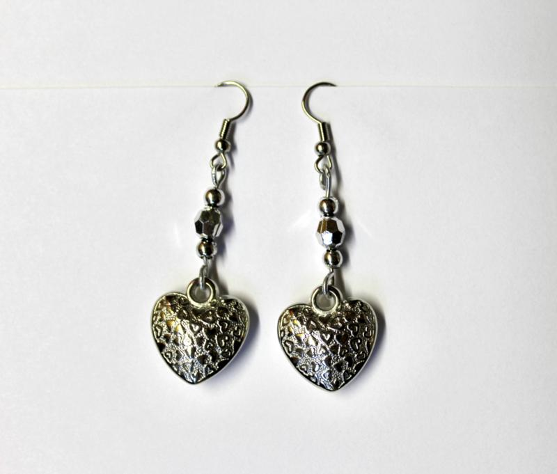 Lichtgewicht hartjes oorbellen ZILVER kleurig - Zilver2 - Lightweight hearts earrings SILVER color