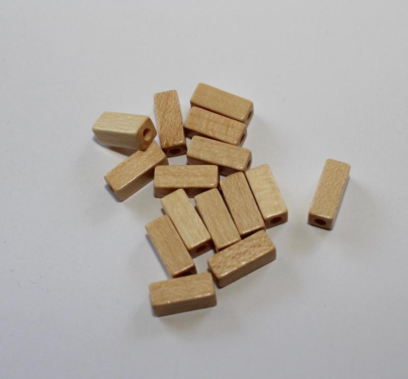 Houten kraaltjes 10 mm lang 4 mm breed - wooden beads 10 mm long x 4 mm wide