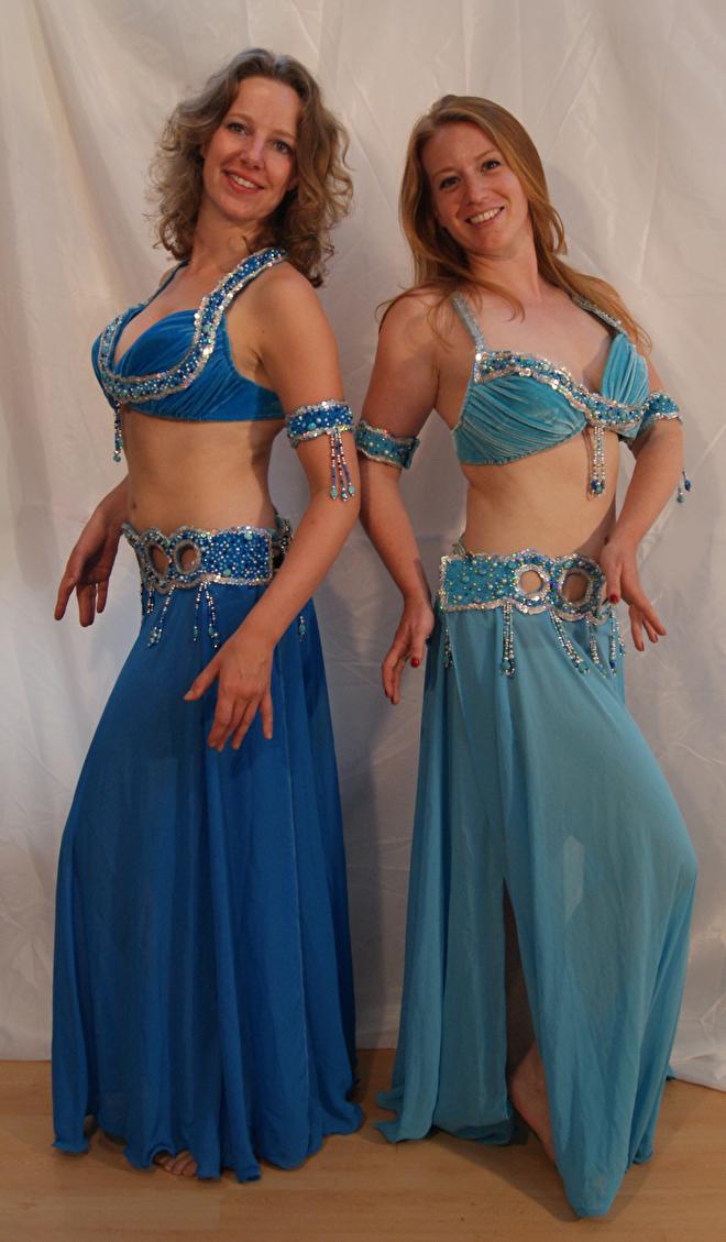 slangen kostuum turquoise