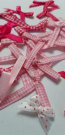 Roze strikjes 21 stuks