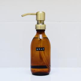 Zeeppomp van glas met label soap    messing pomp
