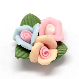 Porceleinen cabochon 3 bloemetjes blauw-roze-perzik
