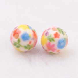 Resin kraal 10 mm met kleurige bloemetjes