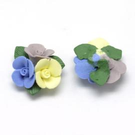Porceleinen bloemkraal blauw-geel-grijs