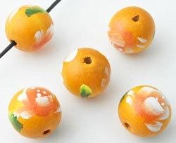 Houten kraal oranje met bloem