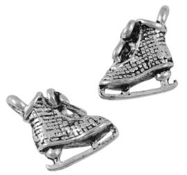 zilverkleurige tibetaanse bedel sport, schaats