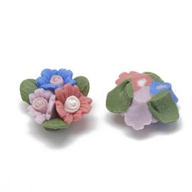 Porceleinen cabochon 3 bloemetjes blauw, roze, steenrood