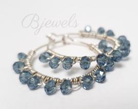 Dames oorbellen sterling zilveren hoops met teal kleurige kristallen