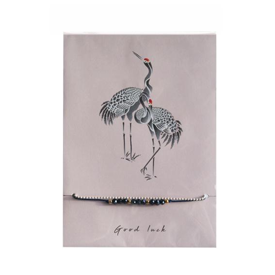 Armbandje op kaart 'Kraanvogel' donkerblauw/goud
