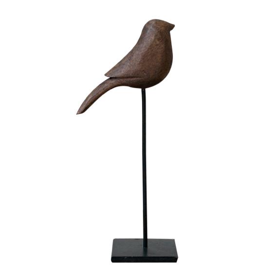 Vogel op voet donker hout