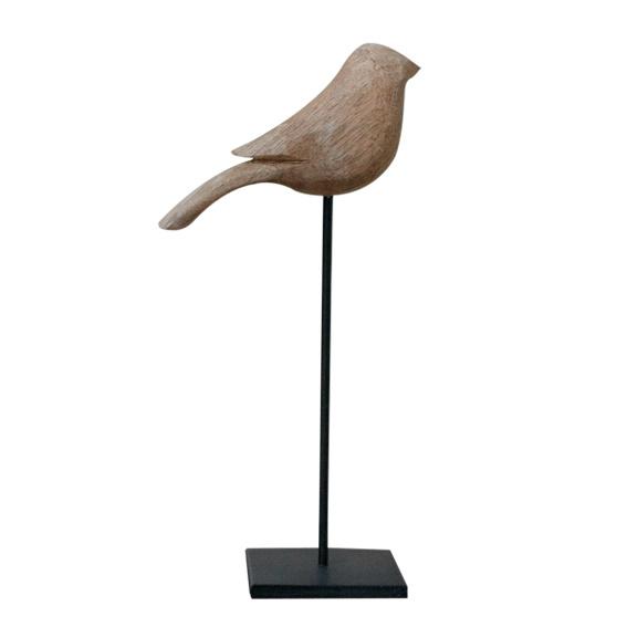 Vogel op voet licht hout