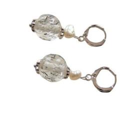 Muranoglas met een zoetwaterparel aan ringen van sterling zilver