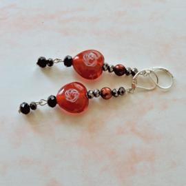 Rode harten van glas met zwart en brons kristal (7 cm lang)