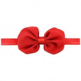 Rode strik van voile op elastiek