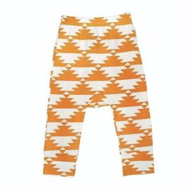 Broekje van zachte tricot katoen met licht oranje in maat 68-74