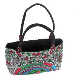 Kleine tas met kleurige halve cirkel met bloem (h x b x d = 15 x 29 x 10 cm)