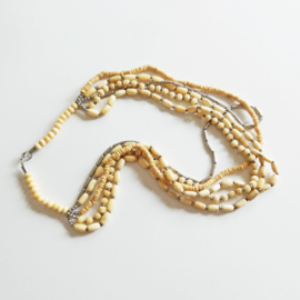Origineel Afrikaanse halsketting van been en metaal (70 cm lang)