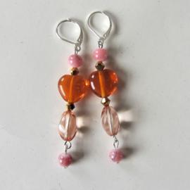Oranje met roze glas en natuursteen