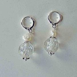 Muranoglas met een zoetwaterparel aan zilveren ringen