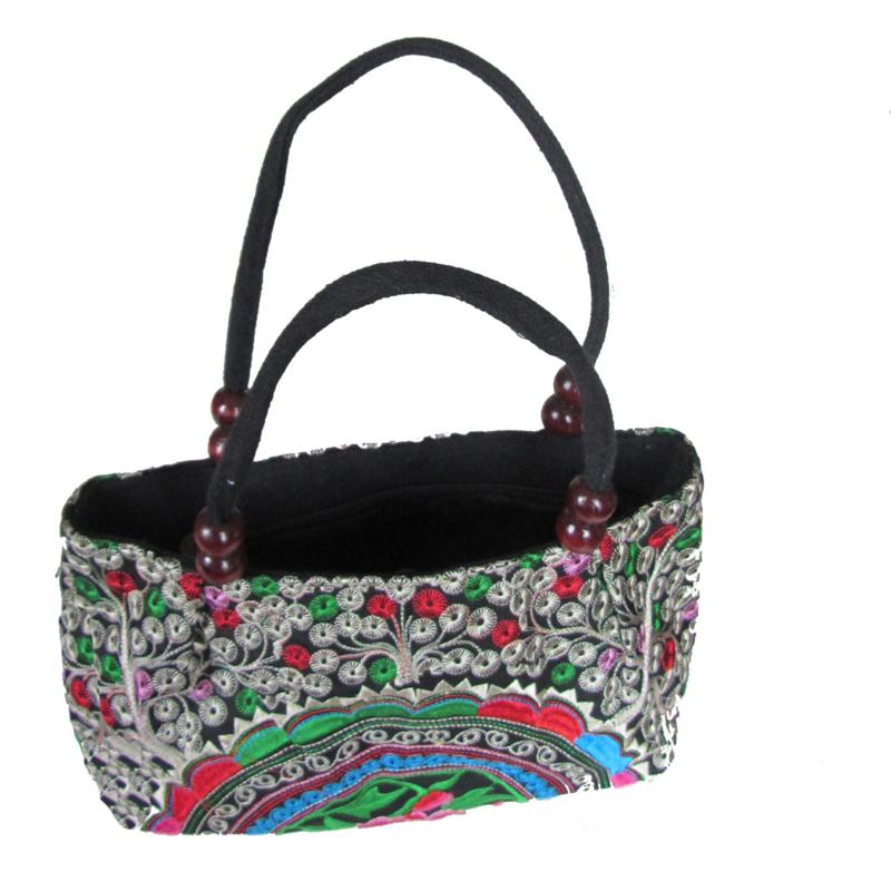 Langwerpige tas met kleurige halve cirkel met bloem (h x b x d = 15 x 29 x 10 cm)