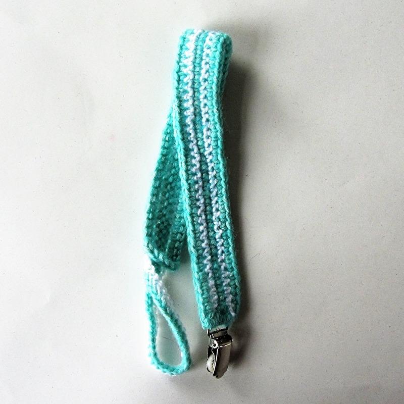 Zeegroen speenkoord met een bretel-clip