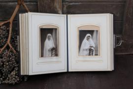 Antiek fotoalbum mét foto's