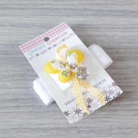 Haarband vlinder geel