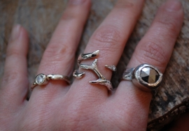Wide silver ring of little branches