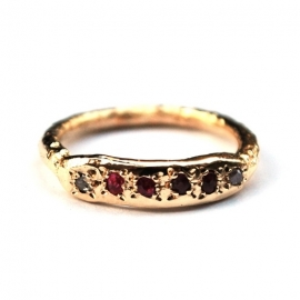 Gold ring with rubies and little diamonds